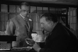 Avec ce cadrage, le spectateur devine que Harry est un peu le prisonnier de son preteur, le patron du bar.