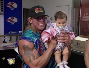 ultimate-warrior-holding-a-baby